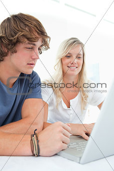 A couple looking at the laptop