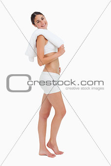 Side view of a slim woman holding a towel