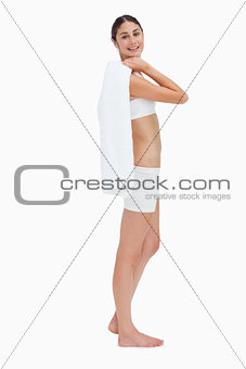 Side view of a slim smiling woman holding a towel