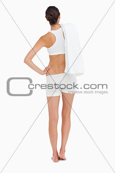 Rear view of a slim woman holding a towel