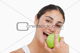 Close-up a brunette eating a green apple