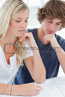 Close up of a worried couple waiting for a pregnancy test result