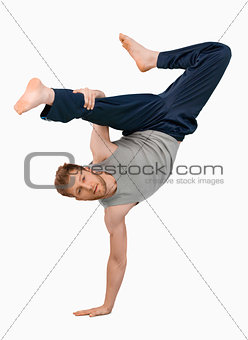 Break dancer doing an one handed handstand