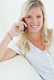 Close up of a woman smiling as she talks on the phone