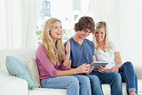 Laughing siblings share the one tablet pc