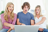 Shocked siblings at what is on the laptop