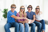 A group of friends watching a scary 3d movie