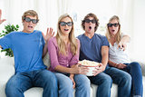 Friends shocked as they watch a scary 3d movie