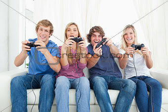 A group of friends playing video games together