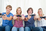 A smiling gang of friends as they look at the camera while gamin