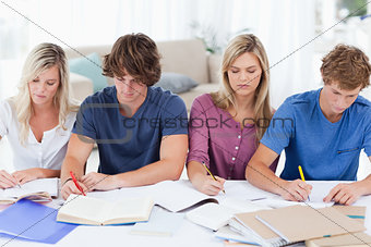 Four students sitting together and studying