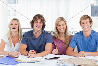 Four smiling students looking into the camera
