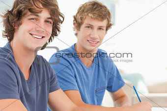 Two male students looking into the camera and smiling