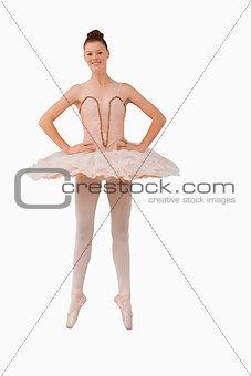 Smiling ballerina standing on her tiptoes
