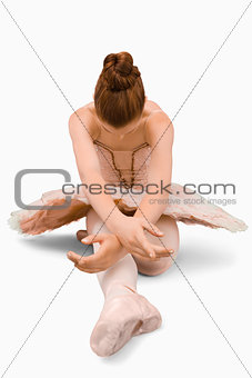 Sitting ballerina doing stretches
