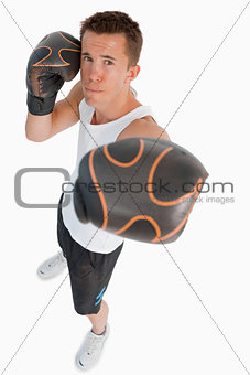 High angle view of punching boxer