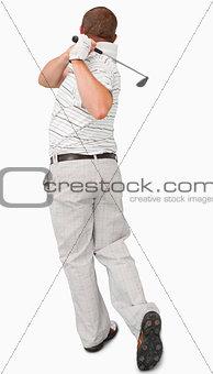 Rear view of golfer