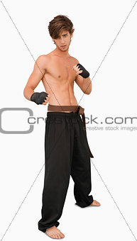 Martial arts fighter standing in fighting pose