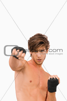 Martial arts fighter in offensive pose