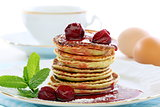 Pancakes with cherry sauce.