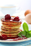 Small pancakes with fruit sauce.