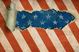 Ripped paper hole in grunge USA flag