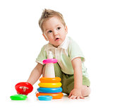 Cute kid playing colorful tower isolated on white