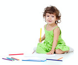 Little girl drawing with yellow pencil
