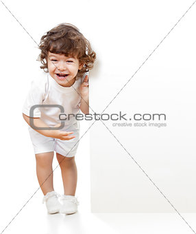 Curly funny girl holding blank advertising banner