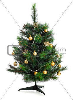 Small decorated christmas tree isolated on white
