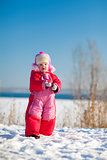 child with snow in winter