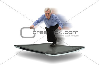 Senior businessman surfing on a PC tablet