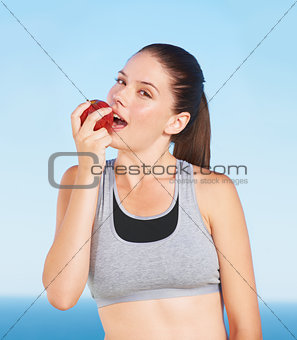 Biting a juicy red apple