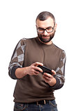 Young man playing games on smartphone