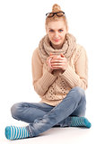 Blond woman holding cup of hot drink