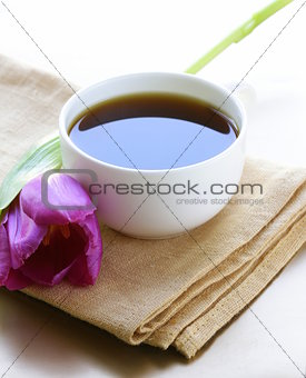 cup of black coffee and flower tulip