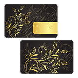 Luxury business card with golden swirls and golden label