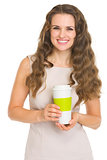 Smiling young woman with coffee cup