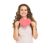 Happy young woman showing valentine's day cards