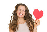 Smiling young woman showing valentine's day cards