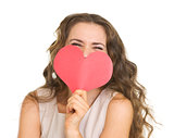 Young woman hiding valentine&#39;s day cards