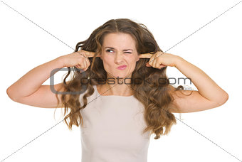 Stressed young woman closing ears