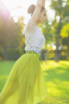 Closeup on girl dancing on meadow