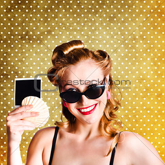 Happy Young Pin-Up Woman Showing Travel Picture