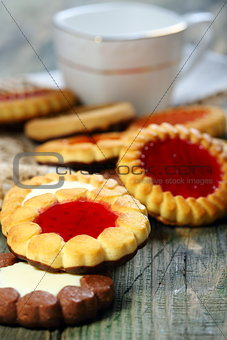 Cup and biscuit with jelly filling.