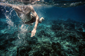 Underwater photo of swimming man