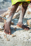 Worker feet salt in salt farm