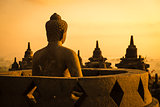 Buddha in Borobudur Temple at sunrise. Indonesia.