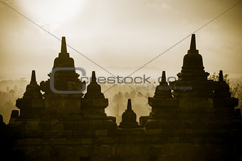 Borobudur Temple wall at sunrise. Indonesia.