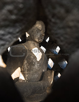 Buddha in stupa BorobudurTemple. Indonesia.